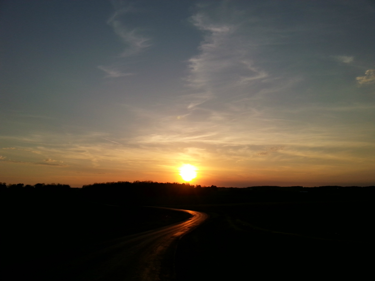 Sunset on a country road (photo)